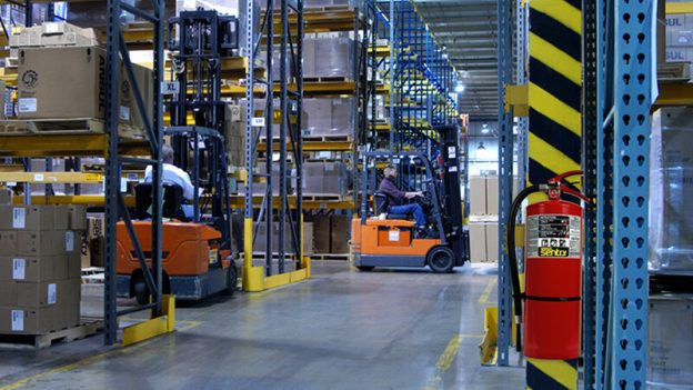 warehouse with forklift shelves and fire extinguisher
