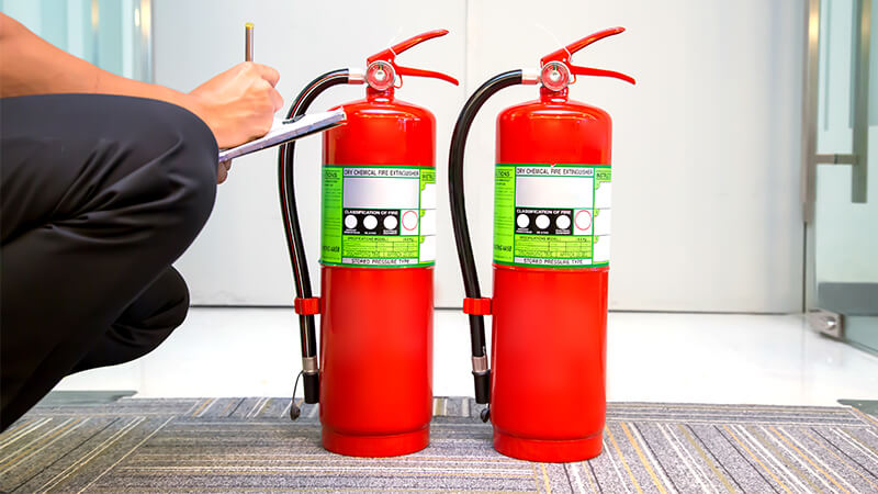 fire extinguisher being inspected