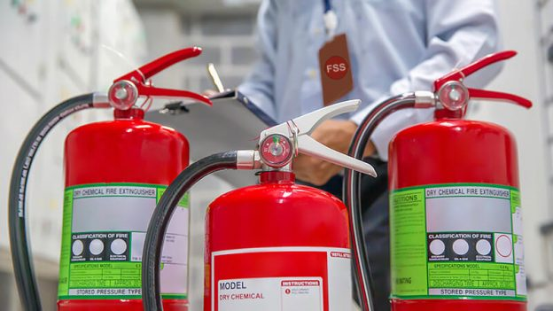 close up of three fire extinguishers