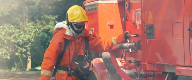 fireman in front of firetruck