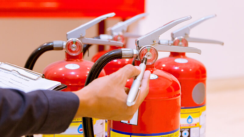 fire extinguishers being checked for safety