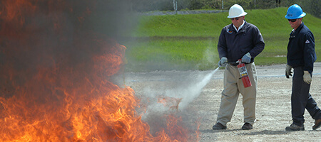 fire simulation training with fire extinguisher used on flames